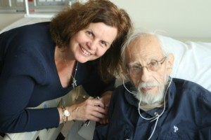 Jane gives the gift of music to Goerge at Lakeridge Hospital.